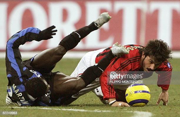 Milan's midfielder Mauri Gattuso vies with Inter Milan's Nigerian forward Obafemi Martins, during their Italian serie A football match at San Siro...