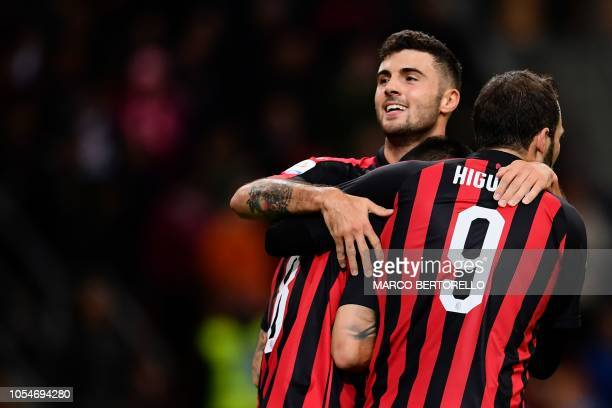 AC Milan's midfielder Suso from Spain celebrates after scoring with his teammate AC Milan's forward Patrick Cutrone from Italy and AC Milan's...