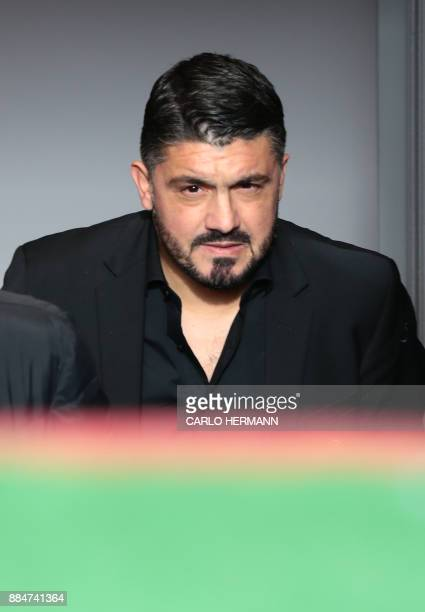 AC Milan's new coach Gennaro Gattuso enters the pitch before the Italian Serie A football match Benevento Calcio vs AC Milan on December 3 2017 at...