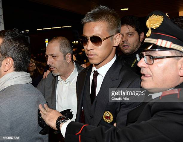 Milan's new signing Keisuke Honda is seen upon arrival at Milano Malpensa Airport on January 4 2014 in Milan Italy