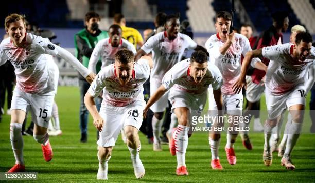 Milan's Norwegian forward Jens Petter Hauge, AC Milan's Belgian midfielder Alexis Saelemaekers, AC Milan's Portuguese defender Diogo Dalot, AC...