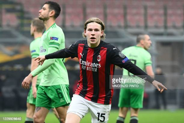 Milan's Norwegian forward Jens Petter Hauge celebrates after scoring the third goal during the UEFA Europa League Group H football match AC Milan vs...