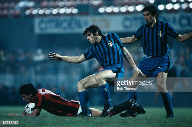 AC Milan's Novellino falls onto the ball under pressure from Inter defenders Giuseppe Baresi and Canuti during the Final of the Copa Super Clubs at...
