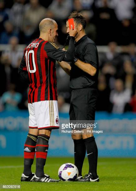 AC Milan's Paolo Di Canio shows referee Mark Clattenburg his own red card during the Steve Harper Testimonial at St James' Park Newcastle