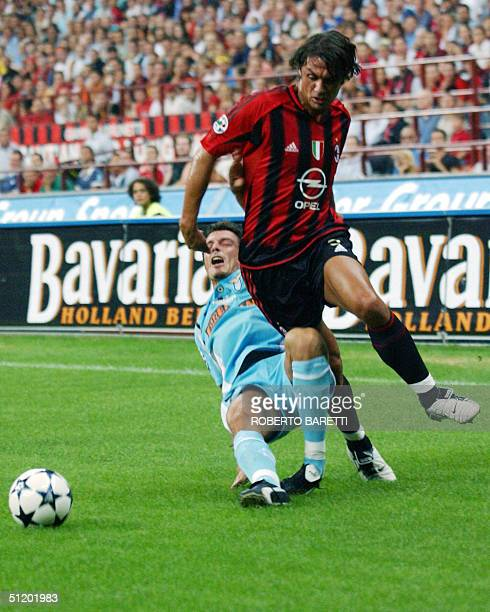 Milan's Paolo Maldini is tackled by Lazio's Massimo Oddo in an Italian SuperCup football final match at San Siro Stadium in Milan 21 Agust 2004