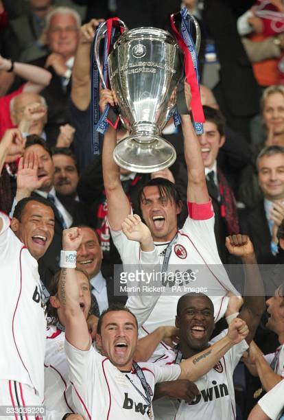 AC Milan's Paolo Maldini lifts the trophy as his side celebrate victory