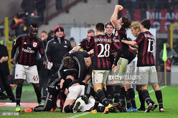 AC Milan's players celebrate after scoring a goal during the Serie A football match between AC Milan and Inter Milan at the San Siro Stadium in Milan...
