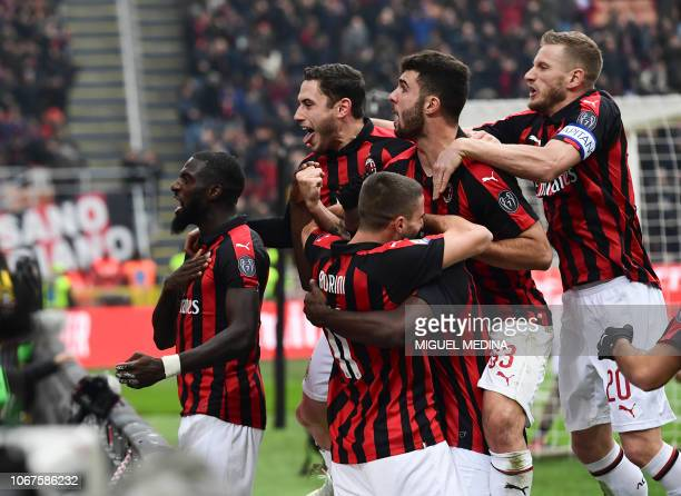 AC Milan's players celebrate after scoring a penalty during the Italian Serie A football match AC Milan vs Parma on Decembre 2 2018 at the San Siro...