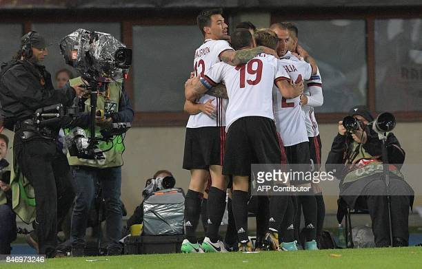 AC Milan's players celebrate after they scored to 10 goal during the UEFA Europa League group D football match FK Austria Wien v AC Milan in Vienna...