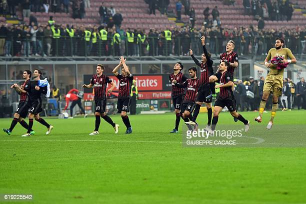 AC Milan's players celebrate at the end of the Italian Serie A football match AC Milan vs Pescara at San Siro Stadium in Milan on October 30 2016 /...