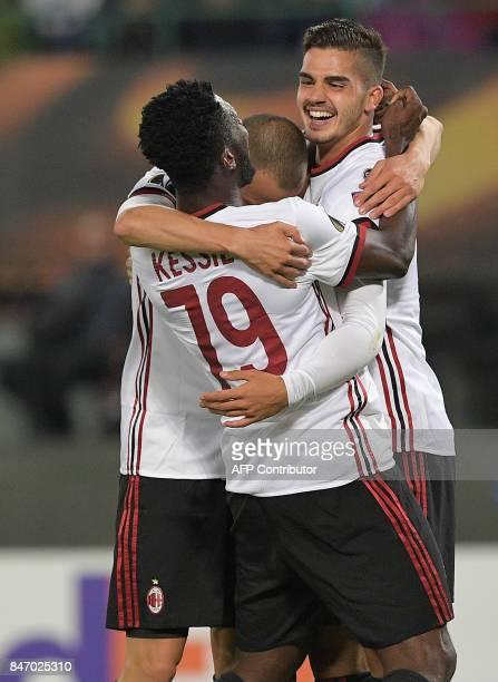 Milan's players celebrate scoring during the UEFA Europa League group D football match FK Austria Wien v AC Milan in Vienna, Austria on September 14,...