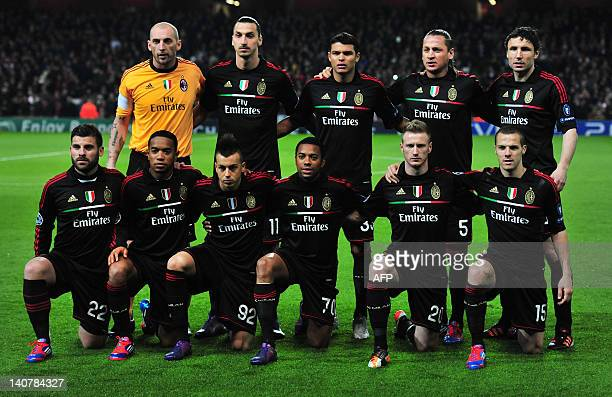 AC Milan's players pose for a team picture before an UEFA Champions League round of 16 second leg football match against Arsenal at the Emirates...