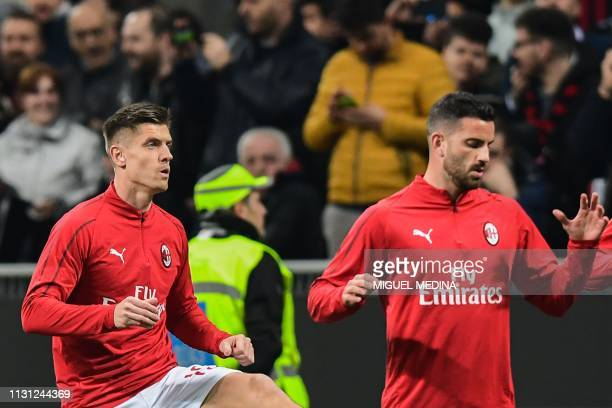 AC Milan's Polish forward Krzysztof Piatek and AC Milan's Argentine defender Mateo Musacchio warm up prior to the Italian Serie A football match AC...