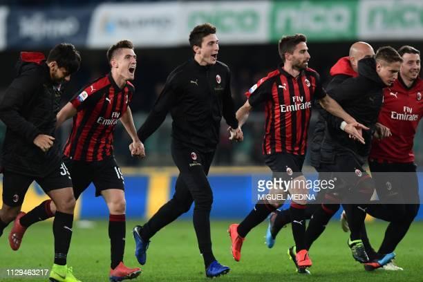 AC Milan's Polish forward Krzysztof Piatek and teammates acknowledge the public at the end of the Italian Serie A football match Chievo Verona vs AC...