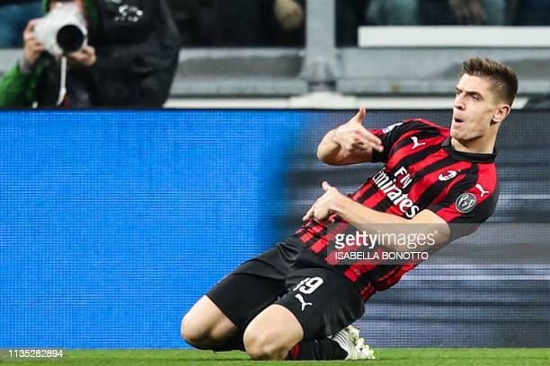 AC Milan's Polish forward Krzysztof Piatek celebrates after opening the scoring during the Italian Serie A football match Juventus vs AC Milan on...
