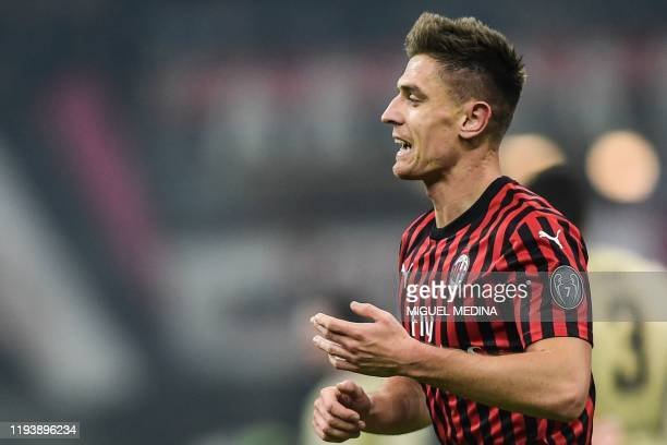 AC Milan's Polish forward Krzysztof Piatek celebrates after opening the scoring during the Italian Cup round of 16 football match AC Milan vs SPAL on...