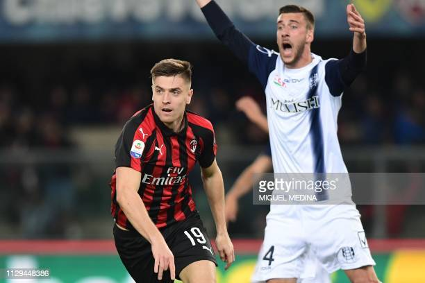 AC Milan's Polish forward Krzysztof Piatek celebrates after scoring as Chievo's Italian defender Mattia Bani reacts during the Italian Serie A...
