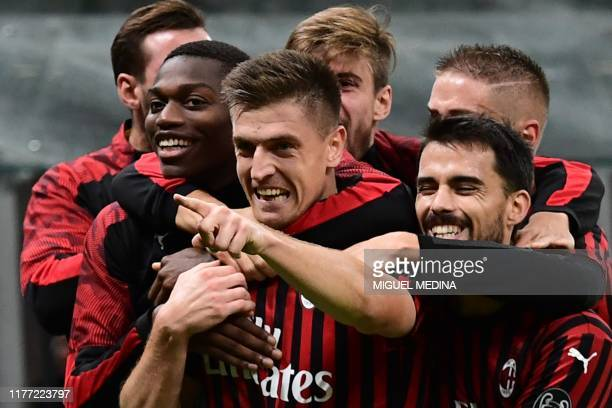 Milan's Polish forward Krzysztof Piatek celebrates after scoring during the Italian Serie A football match AC Milan vs Lecce on October 20, 2019 at...