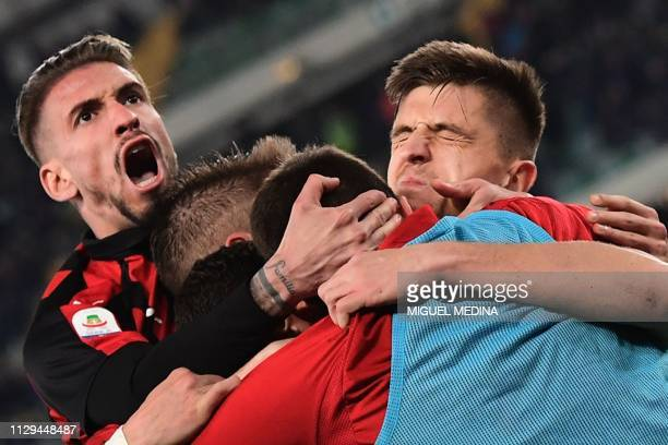 AC Milan's Polish forward Krzysztof Piatek celebrates with AC Milan's Spanish forward Samuel Castillejo and teammates after scoring during the...