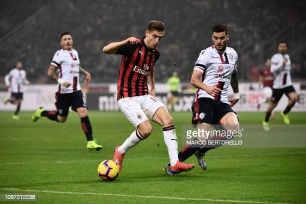 AC Milan's Polish forward Krzysztof Piatek challenges Cagliari's Italian defender Luca Ceppitelli during the Italian Serie A football match AC Milan...