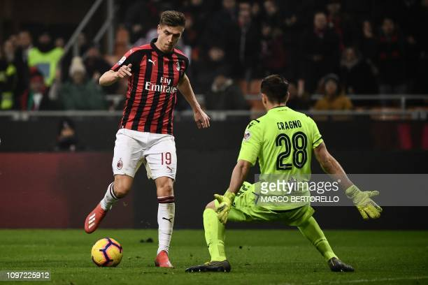 AC Milan's Polish forward Krzysztof Piatek challenges Cagliari's Italian goalkeeper Alessio Cragno during the Italian Serie A football match AC Milan...