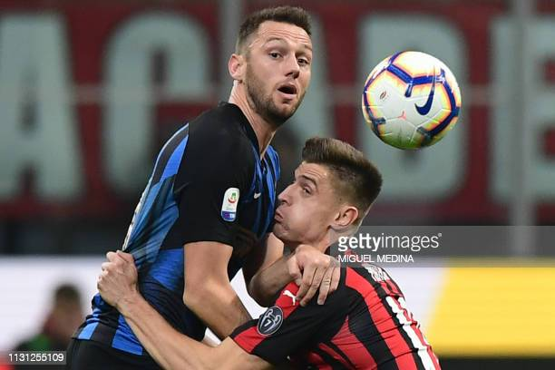 AC Milan's Polish forward Krzysztof Piatek collides with Inter Milan's Dutch defender Stefan de Vrij during the Italian Serie A football match AC...