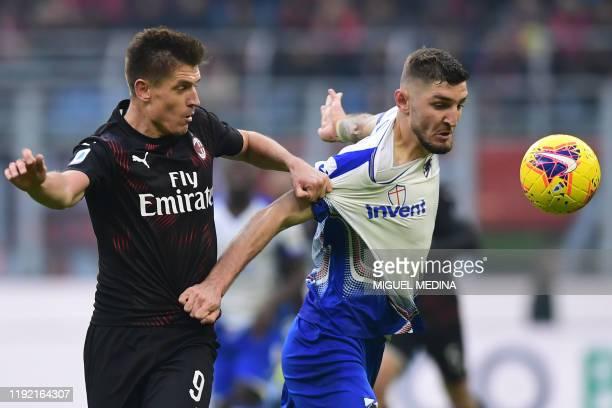 Milan's Polish forward Krzysztof Piatek holds off Sampdoria's German defender Julian Chabot during the Italian Serie A football match AC Milan vs...