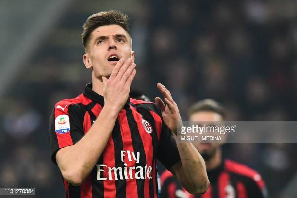 AC Milan's Polish forward Krzysztof Piatek reacts during the Italian Serie A football match AC Milan vs Inter Milan at the San Siro stadium in Milan...