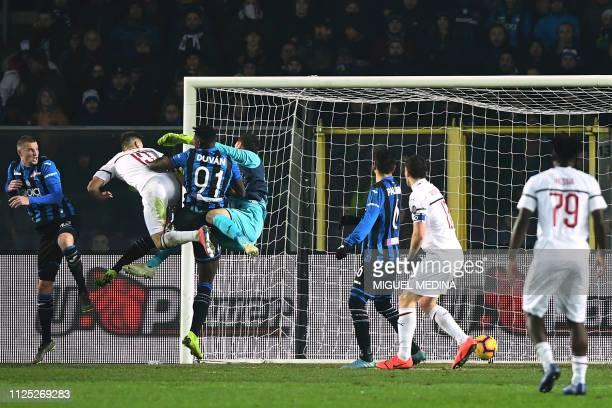 AC Milan's Polish forward Krzysztof Piatek scores his team's third goal past Atalanta's Colombian forward Duvan Zapata and Atalanta's Albanian...