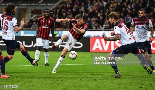 AC Milan's Polish forward Krzysztof Piatek shoots on goal during the Italian Serie A football match AC Milan vs Bologna on May 6 2019 at the San Siro...