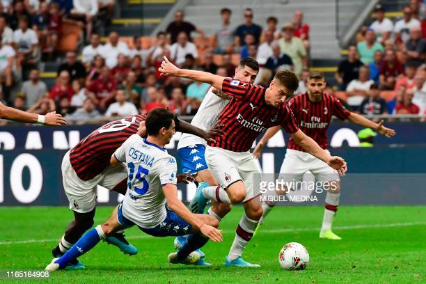 AC Milan's Polish forward Krzysztof Piatek vies with Brescia's Italian defender Andrea Cistana during the Italian Serie A football match AC Milan vs...