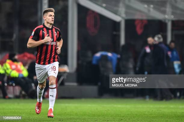 AC Milan's Polish new forward Krzysztof Piatek enters the pitch after a substitution during the Italian Serie A football match AC Milan vs Napoli on...