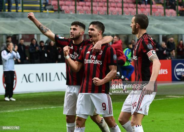 AC Milan's Portuguese forward Andre Silva celebrates after scoring AC Milan's Italian forward Patrick Cutrone and AC Milan's Captain Italian defender...