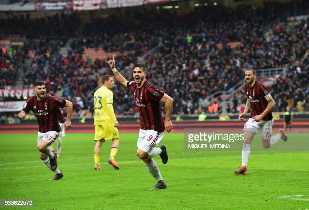 AC Milan's Portuguese forward Andre Silva celebrates after scoring during the Italian Serie A football match AC Milan vs AC Chievo at the San Siro...