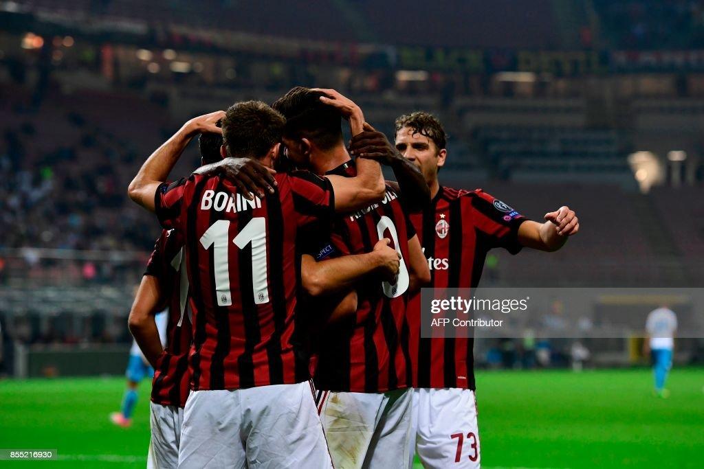 AC Milan's Portuguese forward Andre Silva celebrates with teammates after scoring during the UEFA Europa League football match AC Milan vs HNK Rijeka at the San Siro stadium in Milan on September 28, 2017. /