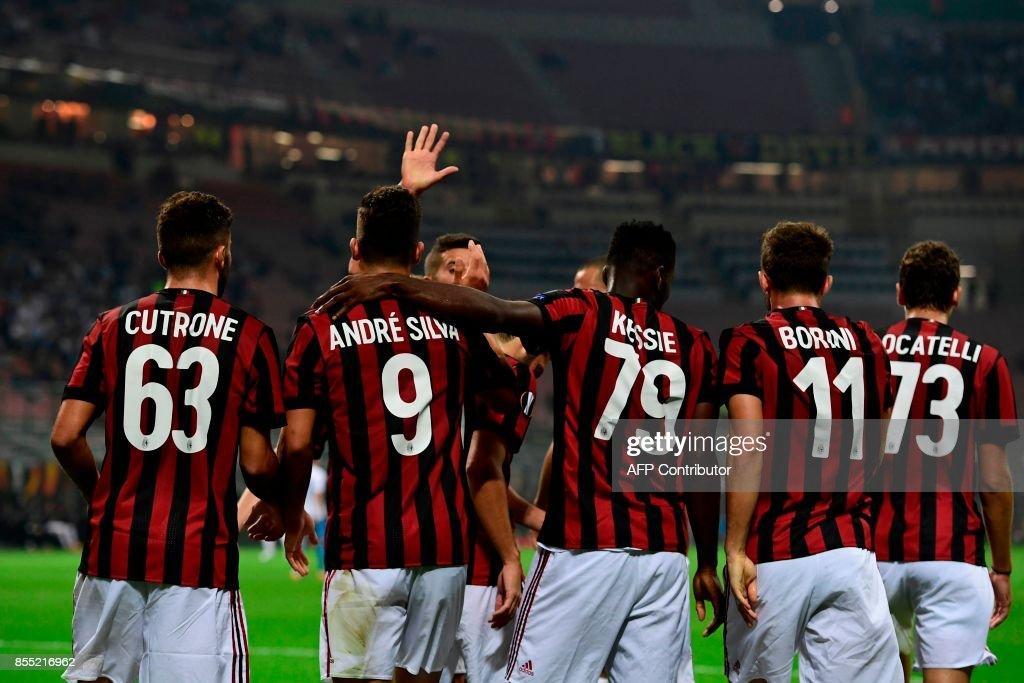AC Milan's Portuguese forward Andre Silva (2ndL) celebrates with teammates after scoring during the UEFA Europa League football match AC Milan vs HNK Rijeka at the San Siro stadium in Milan on September 28, 2017. /