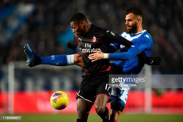 AC Milan's Portuguese forward Rafael Leao fights for the ball with Brescia's Venezuelan defender Jhon Chancellor during the Italian Serie A football...