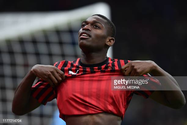 Milan's Portuguese forward Rafael Leao reacts after missing a goal opportunity during the Italian Serie A football match AC Milan vs Lecce on October...