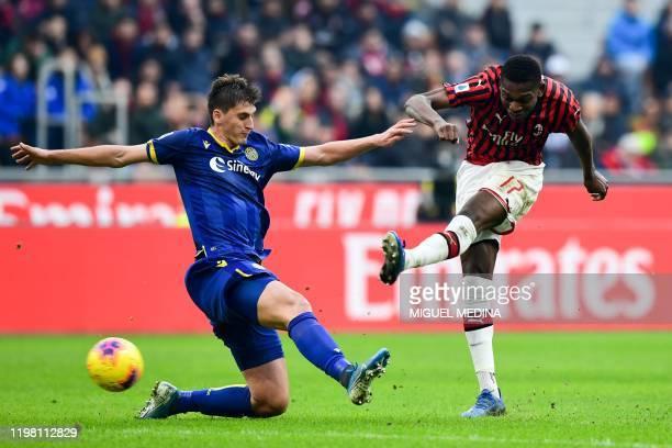 AC Milan's Portuguese forward Rafael Leao shoots past Verona's Albanian defender Marash Kumbulla during the Italian Serie A football match AC Milan...