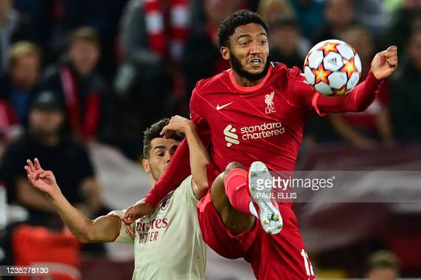 Milan's Spain's midfielder Brahim Diaz vies with Liverpool's English defender Joe Gomez during the UEFA Champions League 1st round Group B football...