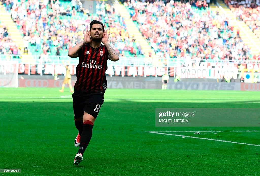 AC Milan's Spanish forward Fernandez Suso celebrates after scoring during the Italian Serie A football match AC Milan vs Palermo at the San Siro stadium in Milan on April 9, 2017. /