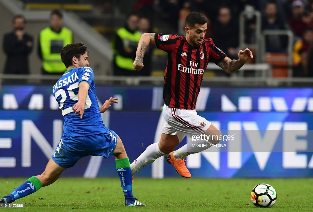 AC Milan's Spanish forward Fernandez Suso (R) vies with Sassuolo's Italian midfielder Francesco Cassata during the Italian Serie A football match between AC Milan and Sassuolo at the San Siro stadium in Milan on April 8, 2018. /
