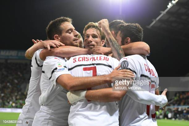 AC Milan's Spanish forward Samuel Castillejo celebrates with comrades after scoring the third goal during the Italian Serie A football match Sassuolo...