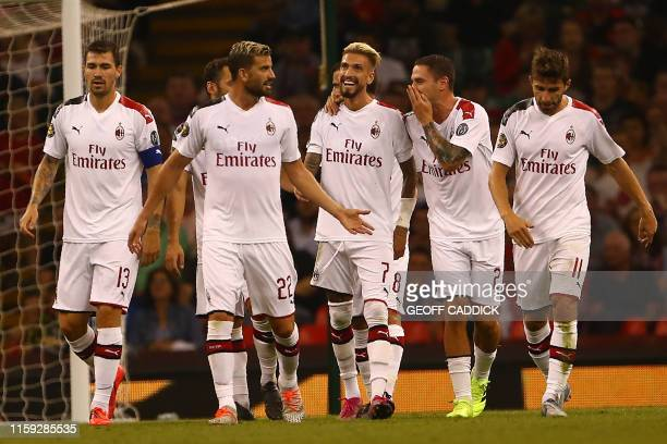 AC Milan's Spanish forward Samuel Castillejo celebrates with teammates after he scores the team's second goal during the 2019 International Champions...