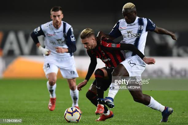 AC Milan's Spanish forward Samuel Castillejo holds off Chievo's Senegalese defender El Hadji Assane Diousse during the Italian Serie A football match...