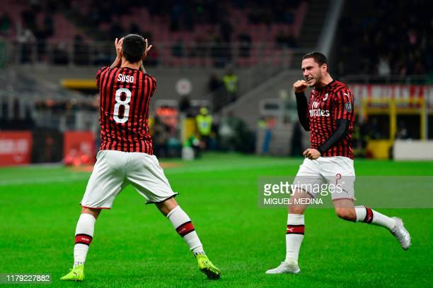 Milan's Spanish forward Suso celebrates scoring his team's first goal with AC Milan's Italian defender Davide Calabria during the Italian Serie A...