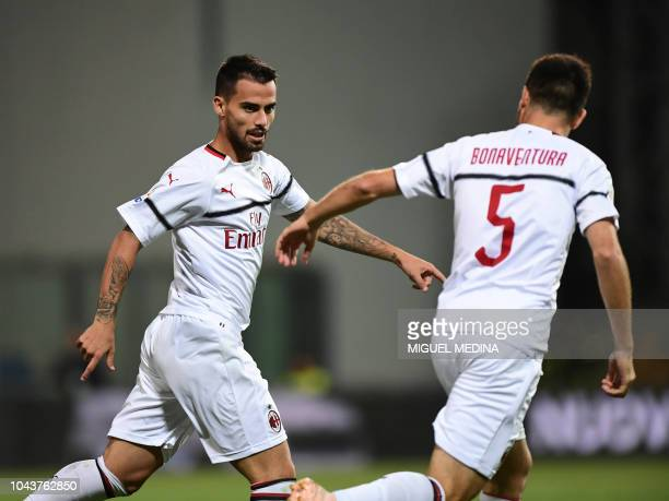 AC Milan's Spanish forward Suso celebrates with AC Milan's Italian midfielder Giacomo Bonaventura after scoring his team's second goal during the...