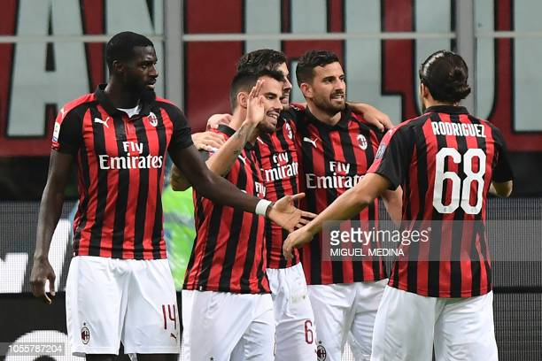 AC Milan's Spanish forward Suso celebrates with teammates after scoring a goal during the Italian Serie A football match between AC Milan and Genoa...