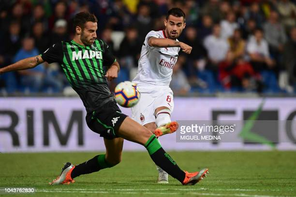 AC Milan's Spanish forward Suso shoots to score his team's second goal during the Italian Serie A football match Sassuolo vs AC Milan on September 30...