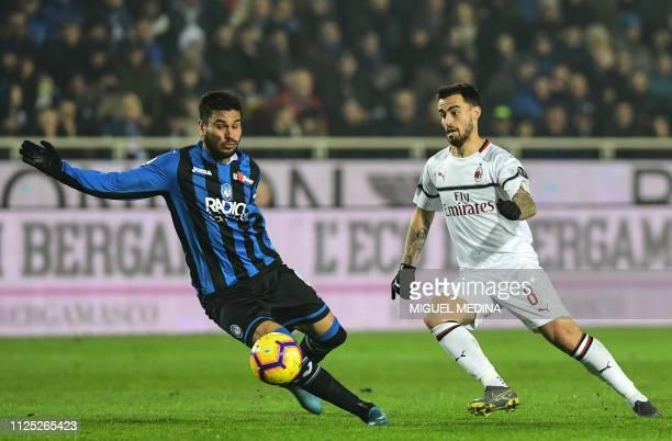 AC Milan's Spanish forward Suso vies with Atalanta's Argentine defender Jose Luis Palomino during the Italian Serie A football match Atalanta vs AC...